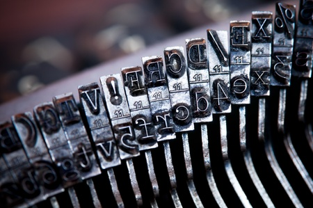 Close-up of old typewriter letter and symbol keys photo