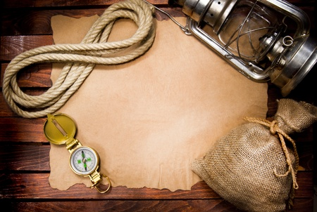 Compass, rope and lamp on old paper  Stock Photo