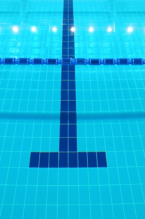 indoor: Detail from indoor swimming pool, water and lines Stock Photo