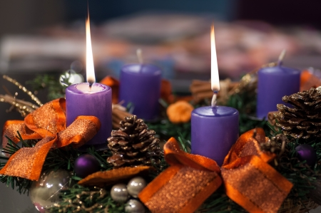 Closeup of burning Christmas candles. A celebratory composition.