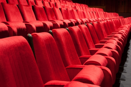 theater seat: Empty red seats for cinema, theater, conference or concert