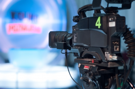 press conference: Video camera lens - recording show in TV studio - focus on camera aperture Stock Photo