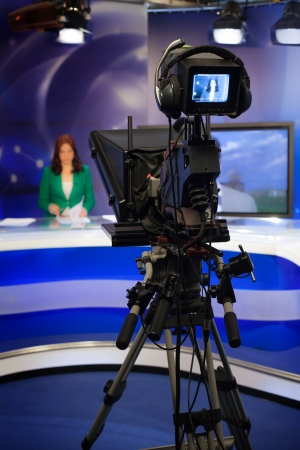 television show: Video camera lens - recording show in TV studio - focus on camera