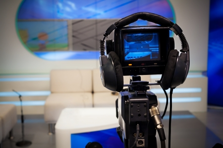 talk show: Video camera lens - recording show in TV studio - focus on camera