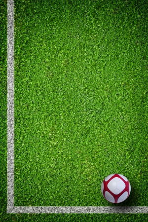 Closeup image of soccer football ball on green grass
