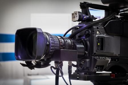 tv camera: Video camera lens - recording show in TV studio - focus on camera aperture Stock Photo