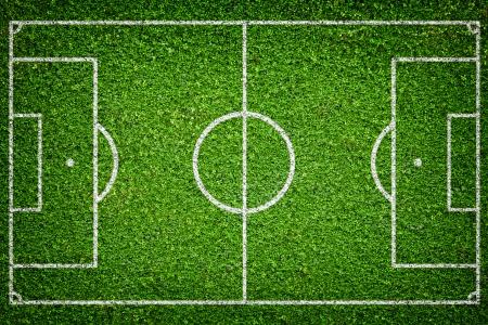 corner kick soccer: Closeup image of natural green grass soccer field Stock Photo