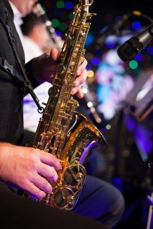 Photo of the male jazz saxophonist playing in sax Stock Photo
