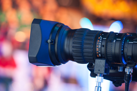 Video camera lens - recording show in TV studio - focus on camera aperture photo