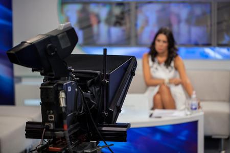 television broadcasting: Video camera - recording show in TV studio - focus on camera