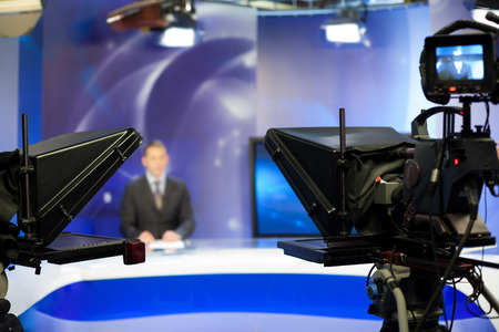 reportage: Video camera lens - recording show in TV studio - focus on camera