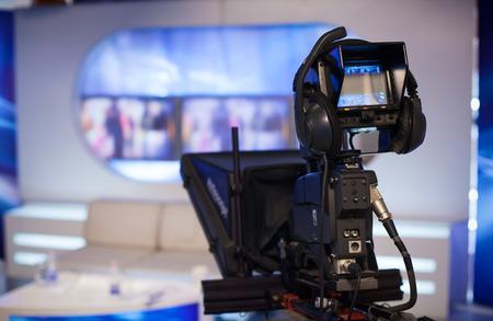 studio lighting: Video camera - recording show in TV studio - focus on camera