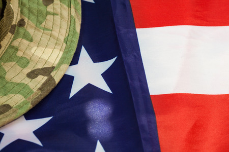 us soldier: US flag with camouflage cap combat hat Stock Photo