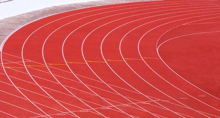 athletics track: stadium track and field area empty on a sunny day Stock Photo