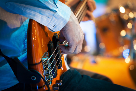 bass player: playing electrical bass guitar, closeup of hands and strings Stock Photo