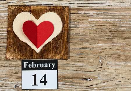 February 14, on the calendar, Valentines day, heart from red paper photo