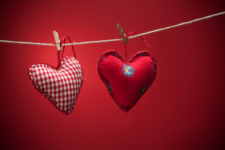hand chain: Colorful fabric hearts on red backgrounds. Valentines Love concept Stock Photo
