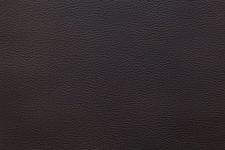 black leather texture: dark brown leather texture closeup can be used as background Stock Photo