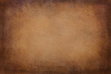 Old vintage brown leather texture closeup can be used as background Stock Photo