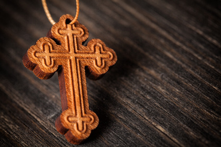 Closeup picture of small wooden christian cross photo