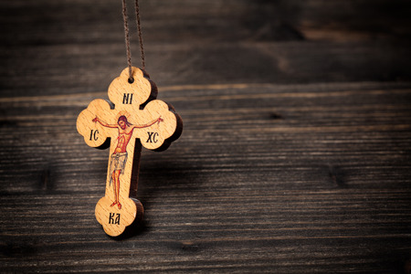 Closeup picture of small wooden christian cross