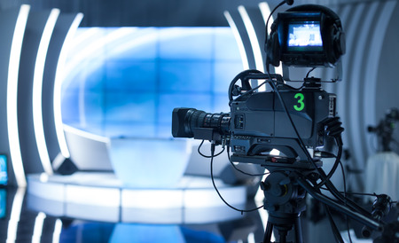 television camera: Video camera - recording show in TV studio - focus on camera