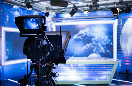 video camera: Video camera - recording show in TV studio - focus on camera
