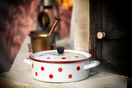 pans: Vintage white cooking pot with red dots