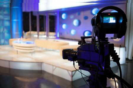 information medium: Video camera - recording show in TV studio - focus on camera