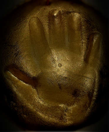 childrens hand print in clay