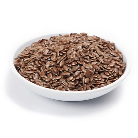 linseed: brown flax seed or linseed isolated on white background Stock Photo