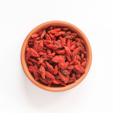 superfood: red goji berry in a bowl isolated