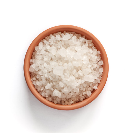Sea salt in bowl on white