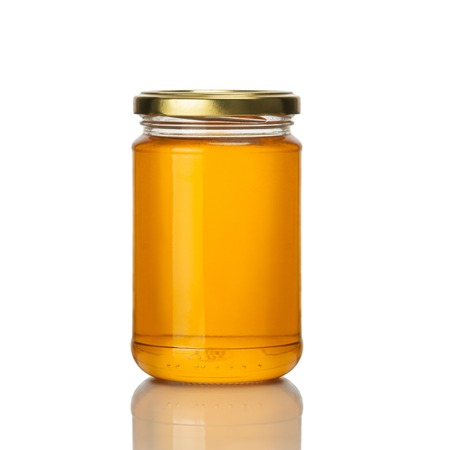 jar: bee honey jar on white background isolated Stock Photo