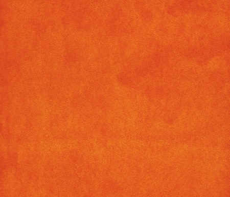 Background with orange texture velvet fabric closeup 写真素材