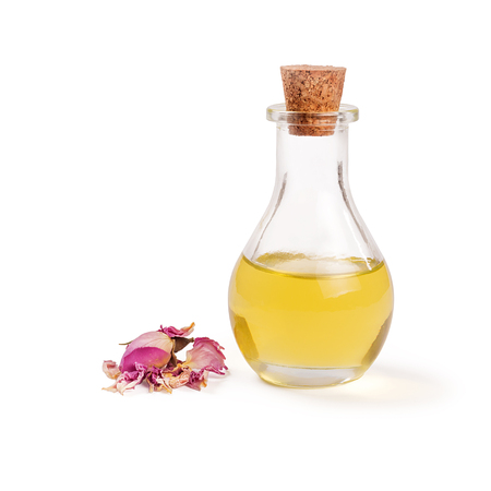 Rose flower petals and buds with aromatherapy essential oil glass bottle isolated over white background Archivio Fotografico