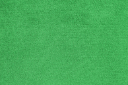 Background with green texture, velvet fabric, close-up