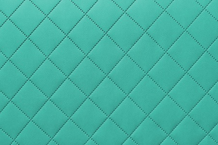 detail of sewn leather, onyx leather upholstery background pattern