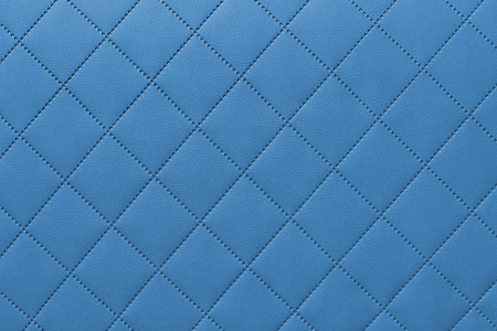 detail of sewn leather, blue leather upholstery background pattern