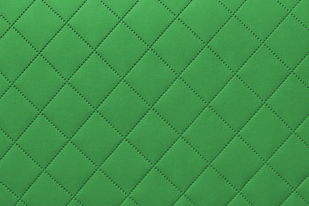 detail of sewn leather, green leather upholstery background pattern