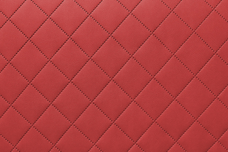 detail of sewn leather, red leather upholstery background pattern