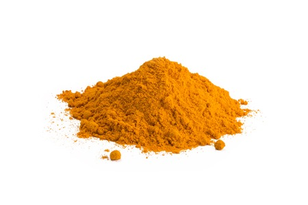 Turmeric powder isolated on white background. Curry powder.