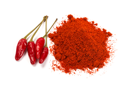 Red chili pepper with chili powder isolated over white Stock Photo