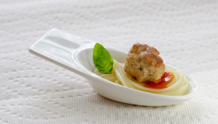 amuse: tasting spoon with meatball and spaghetti
