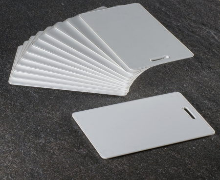 rfid: White RFID cards stacked on grey countertop