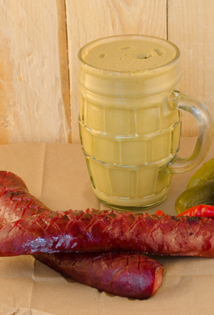 veal sausage: yellow mustard in a jar with sausage and pickle Stock Photo