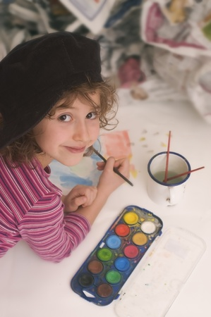 young girl enjoys painting photo