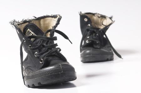 スニーカー: ユニセックスの黒いブーツ 写真素材