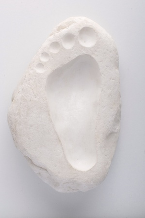 footstep: footstep sculpted on the marble Stock Photo