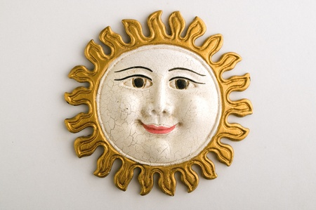 clay craft: handmade ornamental sun face with rays made by terracotta